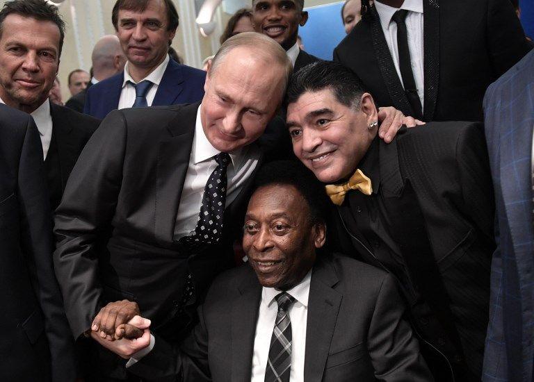 我羅斯總統普汀與馬拉度納、比利合照。法新社