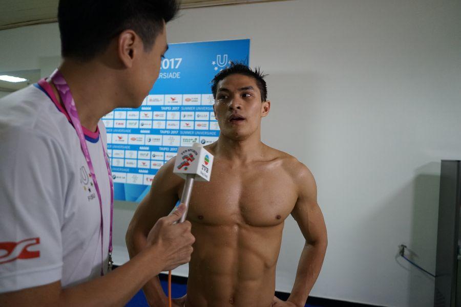 杜敬謙在臺北世大運接受香港TVB記者採訪。圖/台北世大運執委會提供