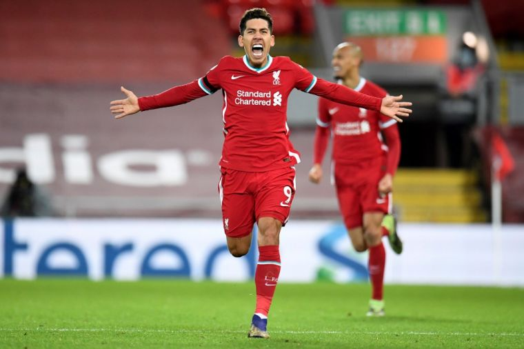 菲爾米諾(前)進絕殺球,利物浦2-1勝熱刺登頂。(法新社)