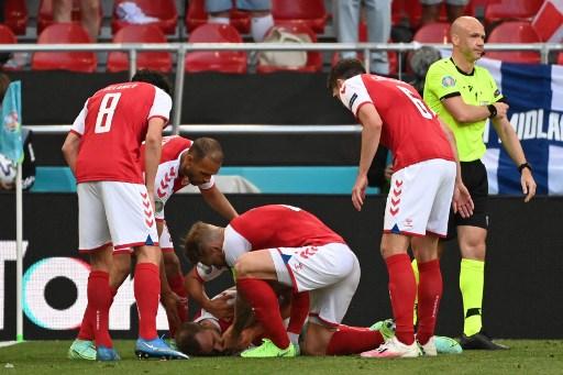 丹麥中場艾歷克森突然在場上倒地昏倒。法新社