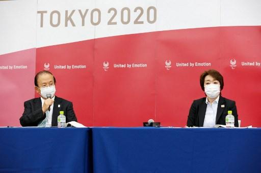 東京奧組委主席橋本聖子(右) 在四方會議後出席記者會。法新社