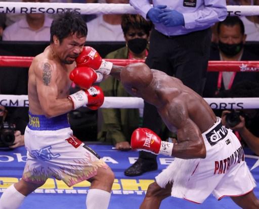 菲律賓拳王帕奎奧(左)意外落敗。法新社