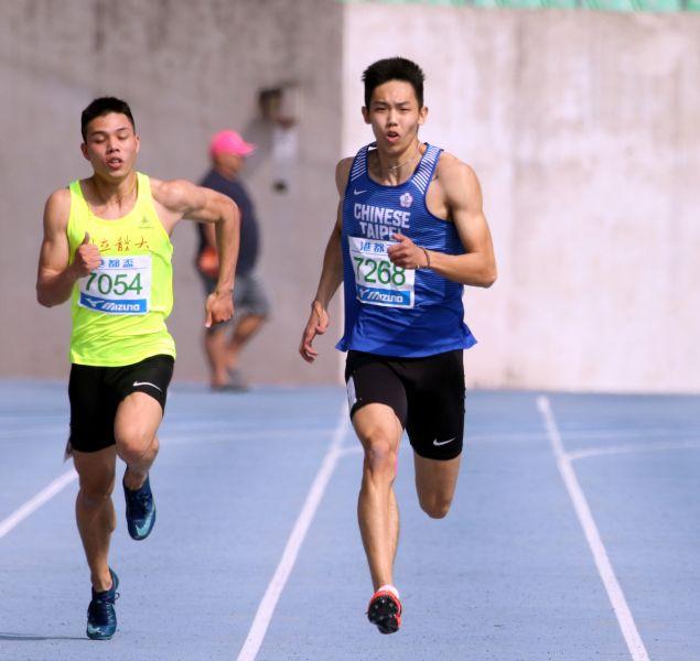 奧運培訓隊彭名揚(前)以21秒03,打破公開男200公尺大會紀錄。林嘉欣/攝影。。林嘉欣/攝影。